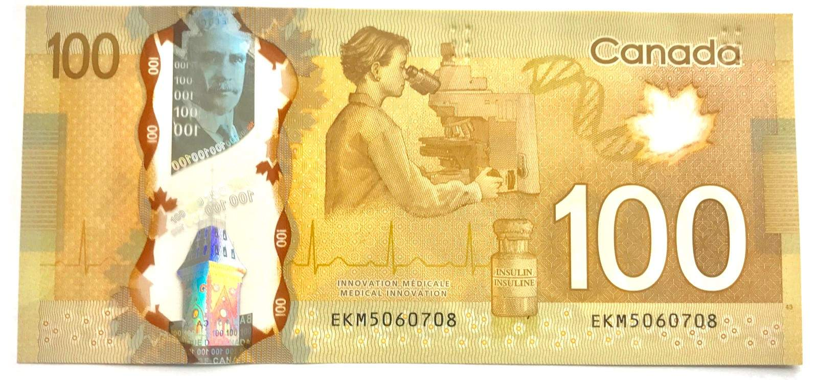 تصویر پشت اسکناس 100 دلاری ، متعلق به کاشف انسولین