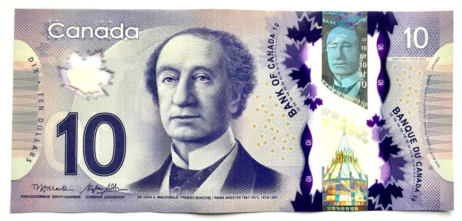 """اسکناس 10 دلاری به رنگ بنفش میباشدو تصویر اولیننخست وزیر کانادا """"John A.Mcdonald"""" و همچنین امضای وی روی آن نقش بسته شده است"""