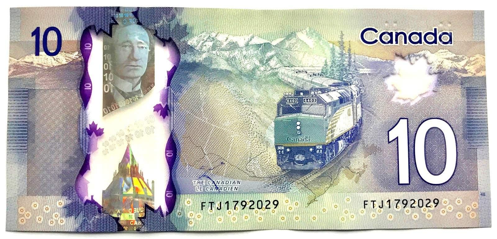پشت اسکناس 10 دلاری کانادا، تصویر خط آهنی که در حال عبور از مناطق کوهستانی کاناداست